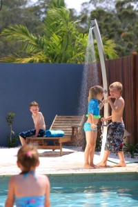 kids playing by Rainware Outdoor Shower
